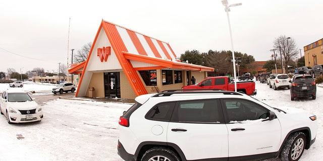 Cars wrap around a Whataburger restaurant as queue to order food after a snow storm on February 17, 2021 in Fort Worth, Texas. Very few restaurants were open during the worst of Winter storm Uri, which brought historic cold weather and power outages to the Lone Star State.