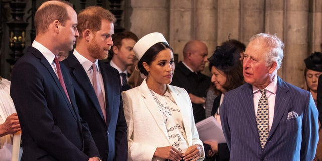 From left to right: Prince William, Prince Harry, Meghan Markle and Prince Charles.  (Richard Pohler / AFP via Getty Images)