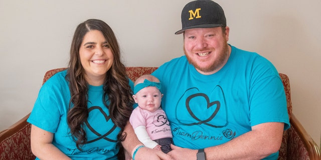 March 17, 2021: Jackie Dennis, left, and her husband, Ricky Dennis, pose for a photo with their daughter, Mia Rose, at Henry Ford Health System in Detroit.