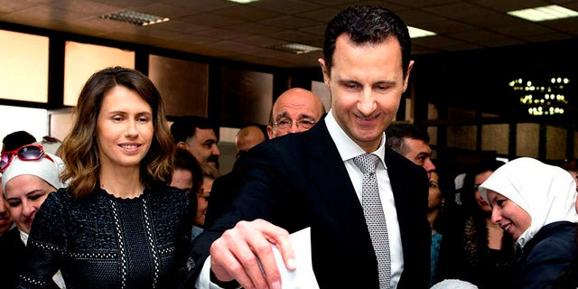 In a statement, Assad's office said the first couple did PCR tests after they felt minor symptoms consistent with the COVID-19 illness. (Syrian Presidency via AP, File)
