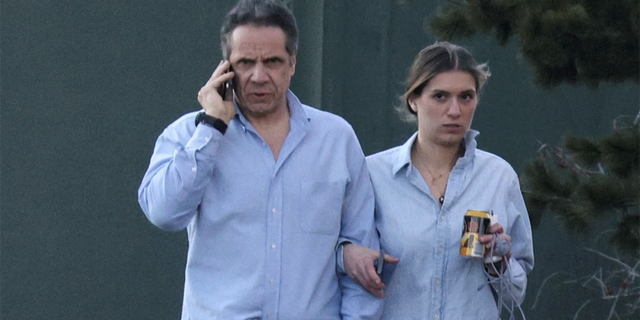 Gov. Andrew Cuomo, walks with daughter Mariah Kennedy-Cuomo on the grounds of the Governor's Mansion on March 12, 2021. Cuomo's campaign is alleged to have helped boost sales of the governor's book by sending at least one note to his email list which was signed in the names of Cuomo's children.