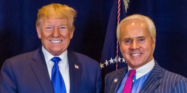 Perry Hooper Jr. poses with former President Donald Trump at a previous event. (Perry Hooper Jr.)