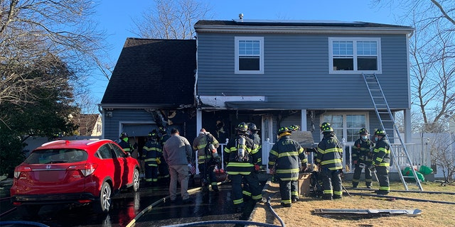 Central Islip firefighters extinguished the flames at the house on Oak Street.