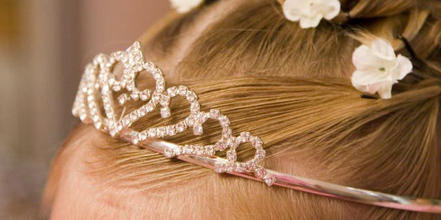 A bride doesn't like the idea of her flower girl wearing a tiara to her wedding, according to a redacted social media post she allegedly shared. (iStock)
