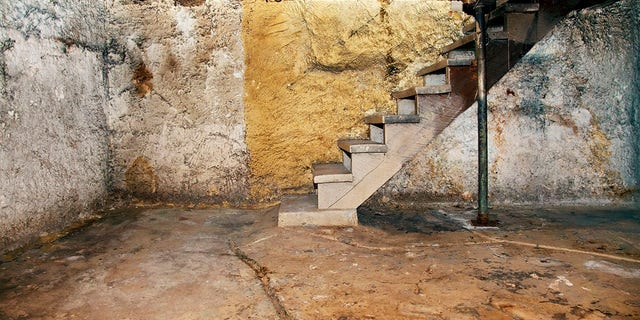 TikTok user Unfortunateexistance claims shefound a trap door hidden under acarpet in her house.