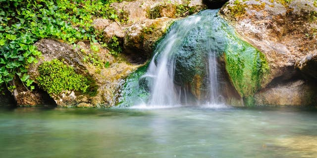 Hot Springs National Park is in central Garland County, Arkansas. It is home to 47 geothermal springs and eight bathhouses. (iStock)