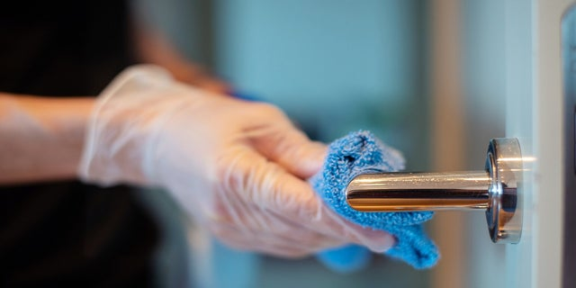Research shows the virus can remain on certain surfaces for up to days. (iStock)