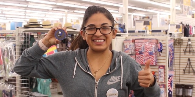 Maqayla DeLaPena, seen here with her Medal of Integrity, also received a bonus as a reward for her honesty and integrity after finding and returning the money.