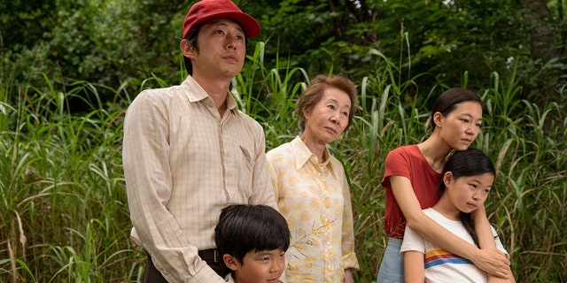 This image released by A24 shows, from left, Steven Yeun, Alan S. Kim, Yuh-Jung Youn, Yeri Han, and Noel Cho in a scene from 'Minari.'