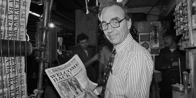 Rupert Murdoch holding up a copy of the New York Post in 1978.