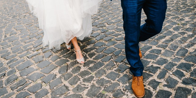 The newlyweds and many of their bridal party who helped a man who was hit by a car in December are law enforcement officers with the Marion County Sheriff's Office in Florida. (iStock)