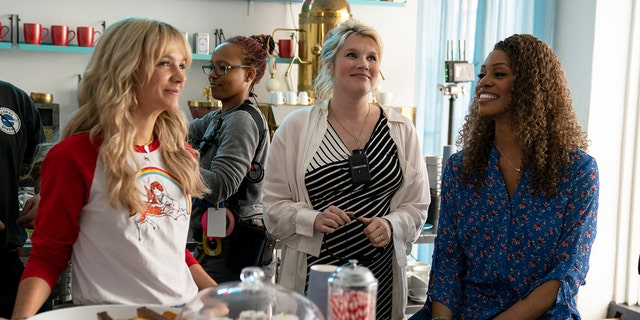 This image released by Focus Features shows Carey Mulligan, left, Emerald Fennell, and Laverne Cox on the set of 'Promising Young Woman.'