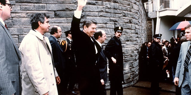 This photo taken by presidential photographer Mike Evens on March 30, 1981 shows President Ronald Reagan waving to the crowd just before the assassination attempt on him, after a conference outside the Hilton Hotel in Washington, D.C.. Reagan was hit by one of six shots fired by John Hinckley, who also seriously injured press secretary James Brady (just behind the car). Reagan was hit in the chest and was hospitalized for 12 days. Hinckley was aquitted 21 June 1982 after a jury found him mentally unstable.