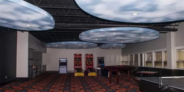 The home also features arcade games and a basketball court.