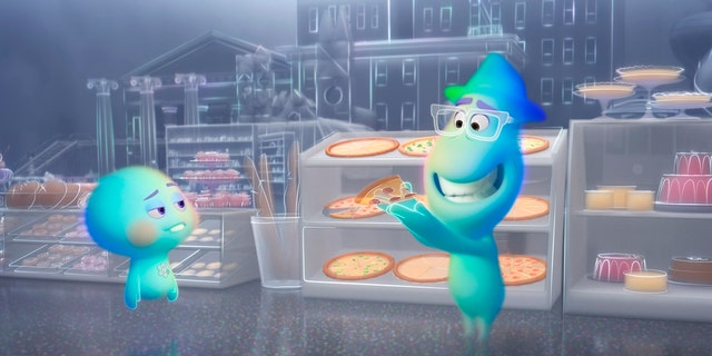 This image released by Disney-Pixar shows the character 22, voiced by Tina Fey, left, and Joe Gardner, voiced by Jamie Foxx, in a scene from the animated film 'Soul.'