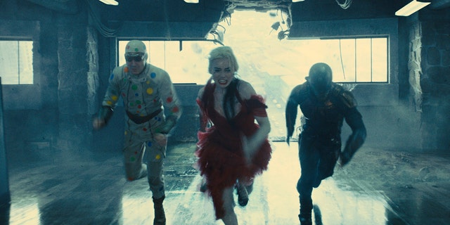 David Dastmalchian, Margot Robbie and Idris Elba in'The Suicide Squad,' due to hit theaters and HBO Max on Aug. 6.