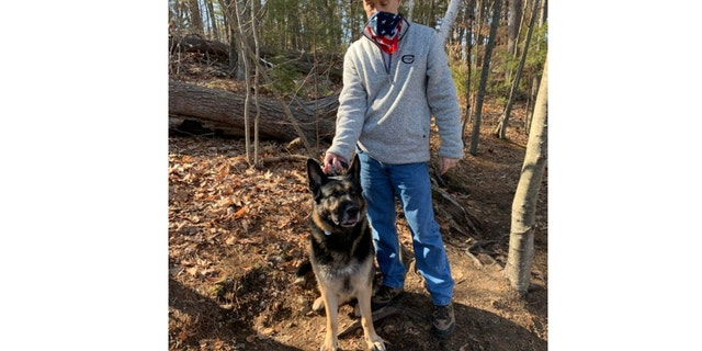 Thomas Walsh and his 5-year-old German Shepherd, Diesel, helped rescue a man who fell through the ice Wednesday. (Stoneham Fire Department)