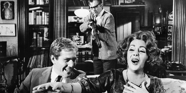 Left to right: George Segal, Richard Burton and Elizabeth Taylor in 'Who's Afraid of Virginia Woolf?' (1966). (Photo by George Rinhart/Corbis via Getty Images)