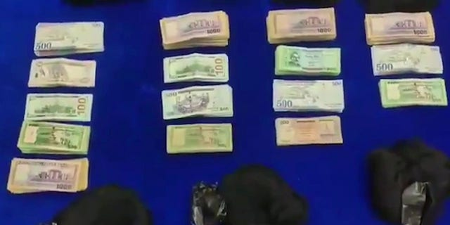 Wig smugglers caught with gold cash