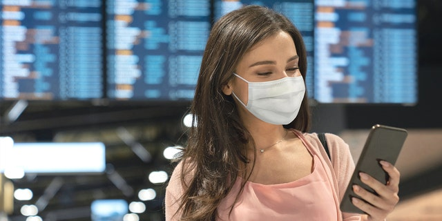 """""""So if you choose to travel, TSA reminds you to please continue to wear your mask,""""TSA spokesperson Lisa Farbstein tweeted on Wednesday."""
