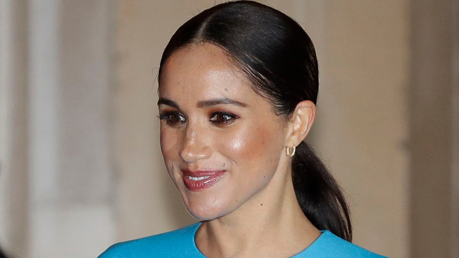Meghan Markle's absence at Prince Philip's funeral 'quietly pleased' royal family, book claims