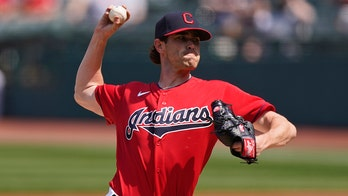 Bieber extends own MLB strikeout record, Indians beat Cubs