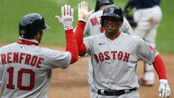 Devers, Bosox win snowy 7th in row; Twins hold silent moment