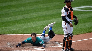 Crawford lifts Mariners over O's 4-2 in doubleheader opener