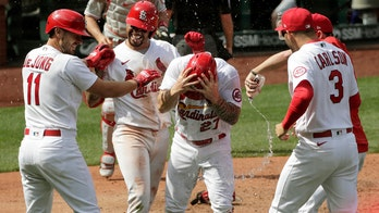 O'Neill scores on game-ending wild pitch as Cards top Phils