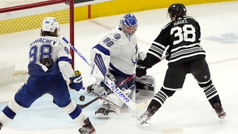 Lightning clinch playoff spot with 7-4 victory over Chicago