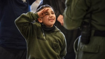 Illinois 7-year-old with life-threatening heart condition becomes SWAT officer for a day