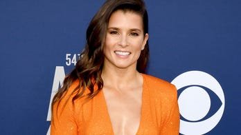 Danica Patrick kisses new man Carter Comstock in adorable beach pics