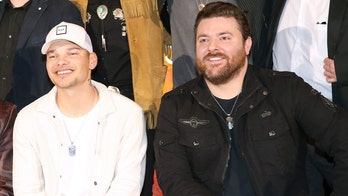 Chris Young surprises Kane Brown on stage to perform their duet 'Famous Friends'