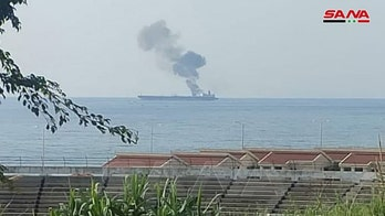 Oil tanker off Syria coast on fire; government says drone attack