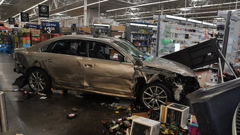 Ex-Walmart employee slams car through store