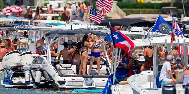 The annual alcohol-fueled Boca Bash attracts thousands of eager boaters, jet skiers, kayakers and paddleboarders to the shallow waters of Lake Boca Raton.