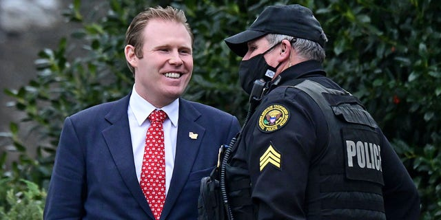 Andrew Giuliani, special assistant to U.S. President Donald Trump and son of Rudy Giuliani, speaks to a Secret Service officer outside the West Wing of the White House in Washington, U.S., January 15, 2021. REUTERS/Erin Scott
