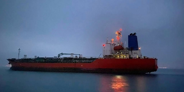 In this photo provided by South Korea Foreign Ministry, The MT Hankuk Chemi leaves the port in Bandar Abbas, Iran, Friday, April 9, 2021. (Associated Press)