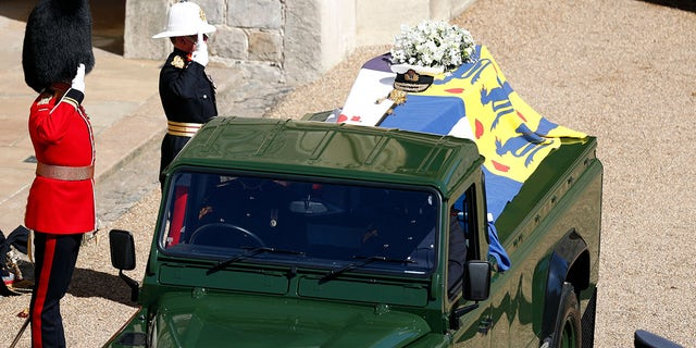 Members of the armed forces pay tribute to the coffin of Britain's Prince Philip, Duke of Edinburgh in the quadrangle ahead of the ceremonial funeral procession.