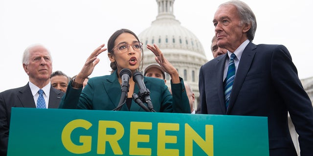 US Representative Alexandria Ocasio-Cortez, Democrat of New York, and US Senator Ed Markey (R), Democrat of Massachusetts, speak during a press conference to announce Green New Deal legislation in 2019. (Photo credit should read SAUL LOEB/AFP via Getty Images)