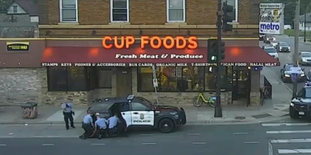 In this image from Minneapolis city surveillance video, Minneapolis police are seen attempting to take George Floyd into custody May 25, 2020, in Minneapolis, Minn. Minn. (Court TV via AP, Pool)