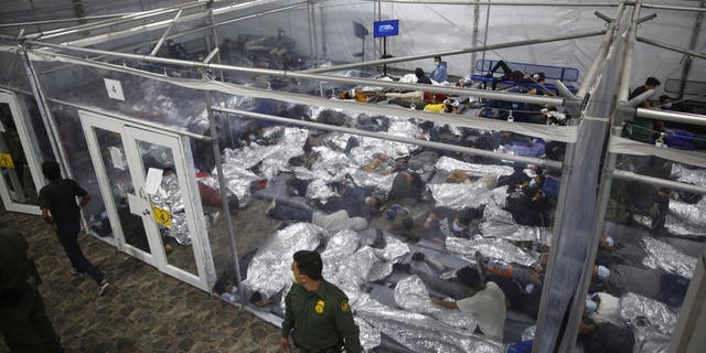 Young minors lie inside a pod at the Donna Department of Homeland Security holding facility, the main detention center for unaccompanied children in the Rio Grande Valley run by U.S. Customs and Border Protection in Donna, Texas. (AP Photo/Dario Lopez-Mills,Swembad)