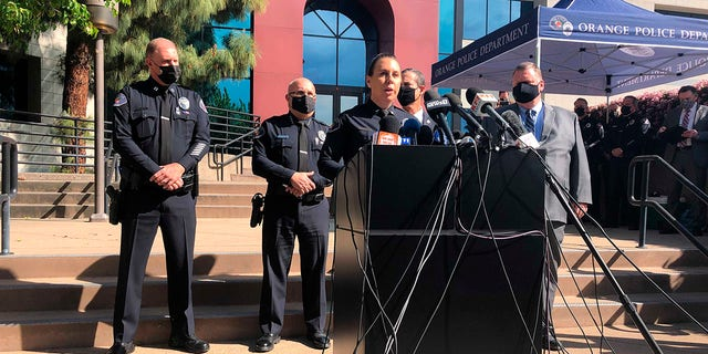 Police Lt. Jennifer Amat talks during a news conference at the Orange Police Department headquarters in Orange, Calif., Thursday, April 1, 2021. A child was among four people killed Wednesday in a shooting at a Southern California office building that left a fifth victim wounded and the gunman critically injured, police said. (AP Photo/Stefanie Dazio)