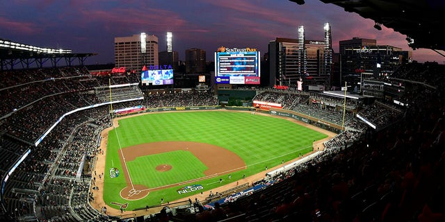 Earth crews prepare field at Sun Trust Park, now known as Truist Park, ahead of Game 3 of MLB Baseball's National League Division Series between the Atlanta Braves and Los Angeles Dodgers in Atlanta on October 7, 2018. (Associated Press)