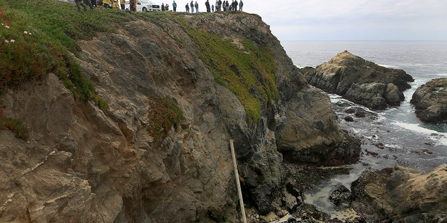 In the Bodega Head parking lot in Bodega Bay, California, a car fell to the left from a wooden fence and landed on a 100-foot-high rocky coastline, killing two people. Bodega Bay firefighters tried to secure the SUV at the crash site. Saturday, April 3, 2021 (Kent Porter/News Democrats through AP)