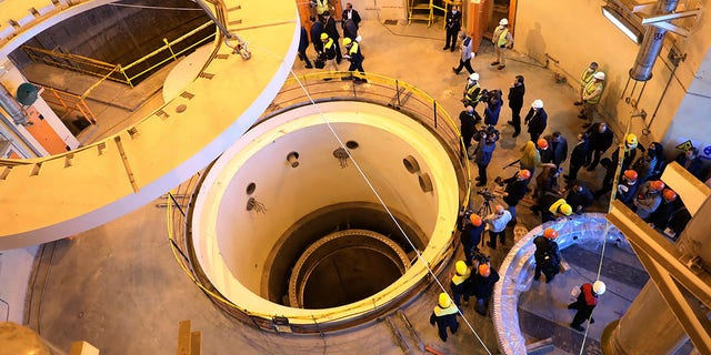FILE - In this file photo dated Monday, Dec. 23, 2019, released by the Atomic Energy Organization of Iran, showing technicians at the Arak heavy water reactor's secondary circuit, as officials and media visit the site, near Arak, 150 miles (250 kilometers) southwest of the capital Tehran, Iran. Efforts to bring the United States back into the 2015 deal on Iran's nuclear program are to step up a gear as Iran and the five world powers remaining in the accord meet in Vienna Tuesday April 6, 2021, while the U.S. is due to start indirect talks with Tehran.(Atomic Energy Organization of Iran via AP, FILE)
