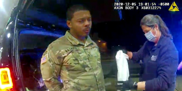 In this image from police video, Caron Nazario is helped by an EMT after he was sprayed with an agent by Windsor Police after a traffic stop on Dec. 20, 2020, in Windsor, Virginia. Nazario says his constitutional rights were violated. (Windsor Police via AP)