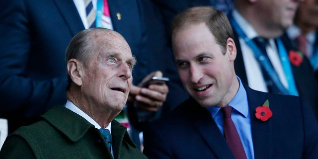 In this 31 October 2015 file photo Britain's Prince Harry on the left and his brother Prince William on the right stand with their grandfather the Duke of Edinburgh as they await the start of the Rugby World Cup final between New Zealand and Australia in Twickenham Stadium, London.  Philip's grandson Prince Harry, who stepped down from royal duties last year and now lives in California, will attend the service along with other members of the royal family, palace officials have said.  His wife, Meghan, Duchess of Sussex, is pregnant and has been advised by her doctor not to take the trip.