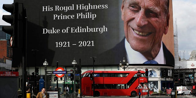 A tribute to Britain's Prince Philip is projected on a big screen at Piccadilly Circus in central London on 9 April.