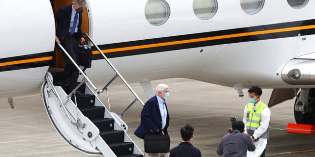 Former U.S. senator Chris Dodd, is followed by former U.S. Deputy Secretary of State James Steinberg as they disembark upon arrival in Taipei, Taiwan on Wednesday, April 14, 2021. (Pool Photo via AP)